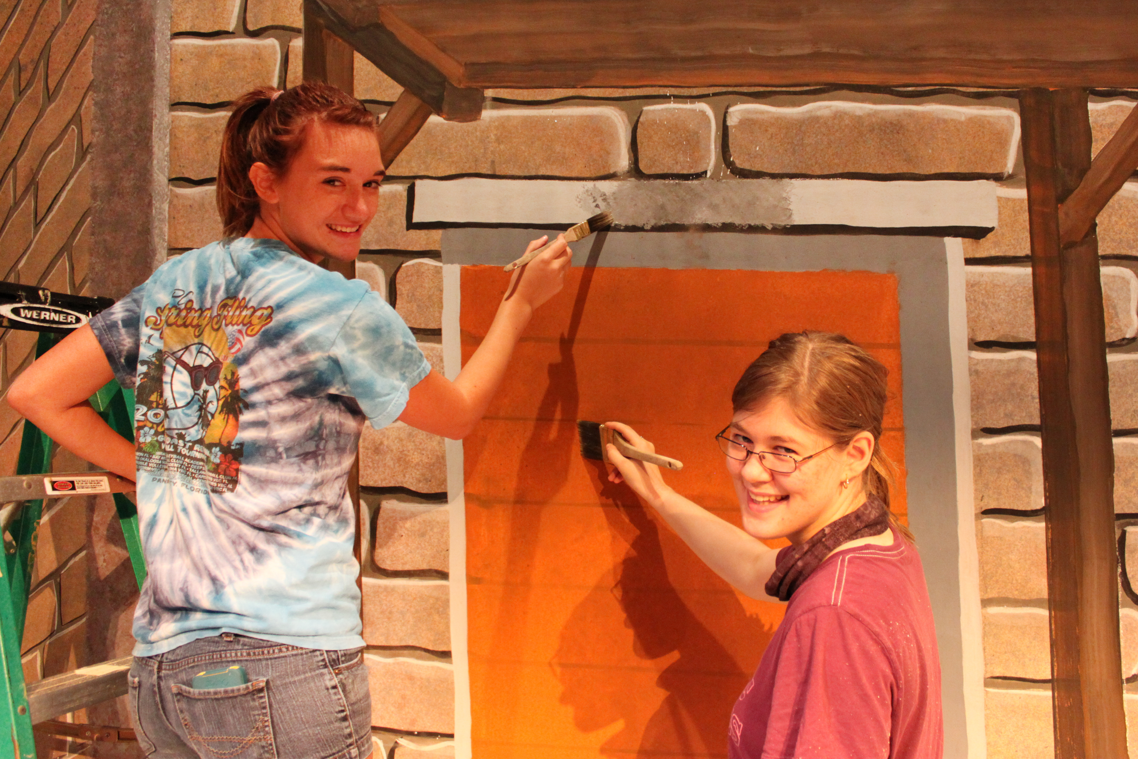 Students painting a set