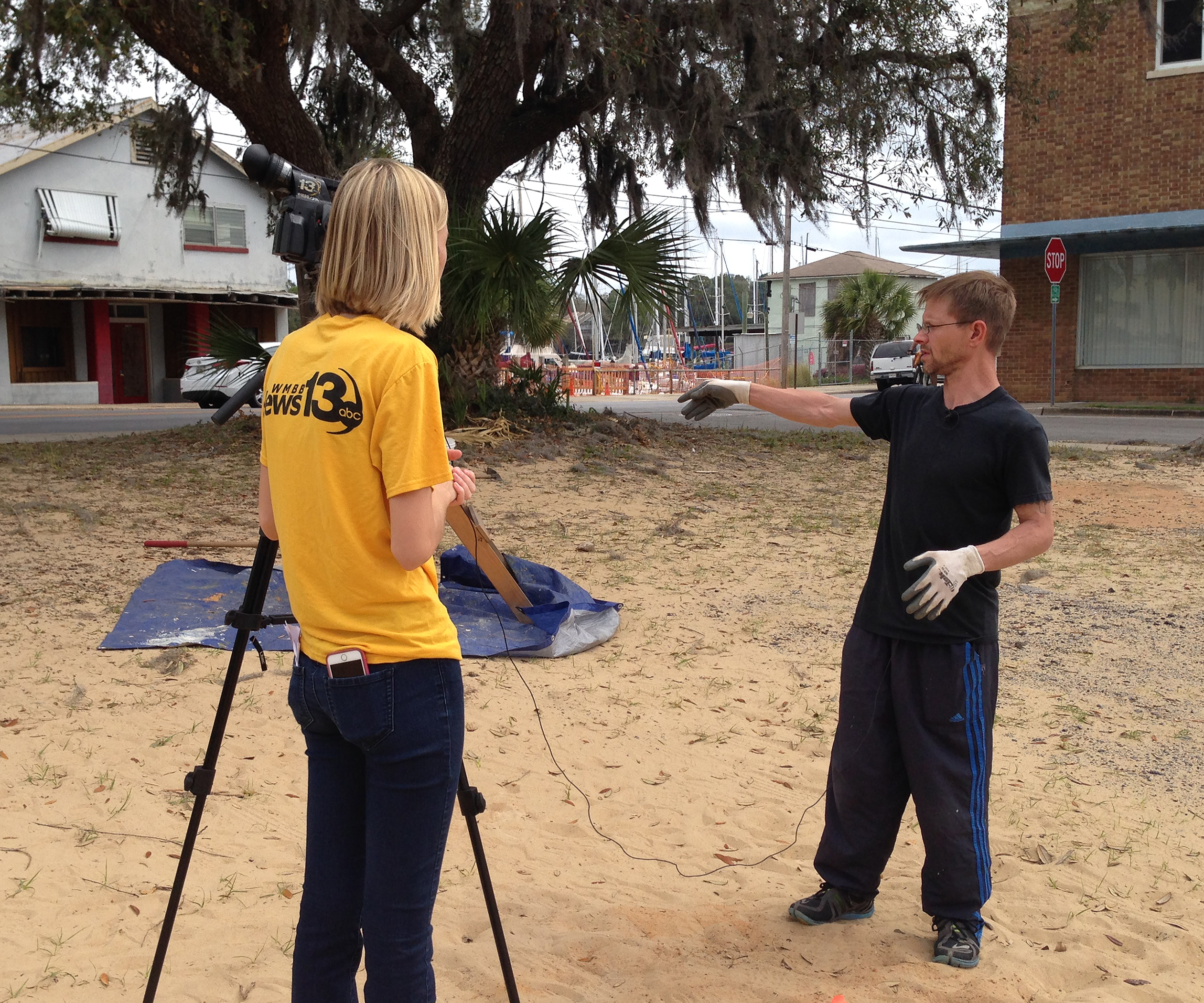 Michael Wright with reporter at archaeological dig